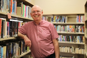John Pateman standing with books