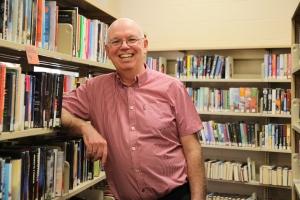 John Pateman standing with books